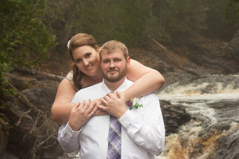 photo of a couple in front of a river